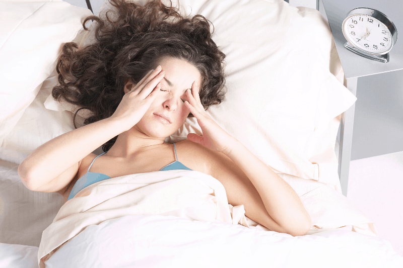 woman having trouble waking up early