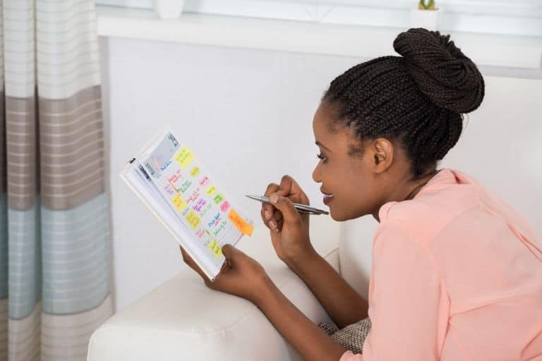 woman looking at her schedule